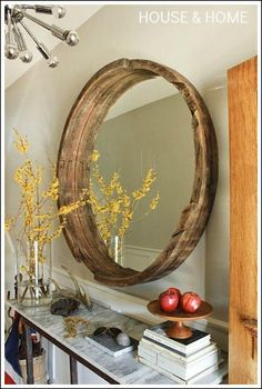 Accessorizing with mirrors! Purchase an old wine barrel, cut it down, and a a mirror sized to fit!