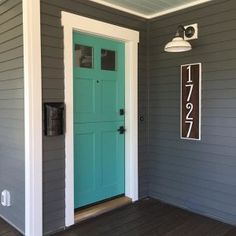 Couldn't wait another second to post this sneak peak of the CUTEST ENTRY EVER on our almost done Thanks for all the comments on the color choice! We went with a gray from (Faded Gray and for the door (Dragon Bay and tagged our fave finishing touches from Teal Front Doors, Teal Door, Turquoise Door, Front Door Paint Colors, Exterior Paint Colors For House, Painted Front Doors, Paint Colors For Home, Navy House Exterior, Blue Doors