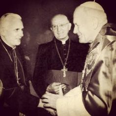 Pope John Paul II, Pope Benedict XVI, and Pope Francis pictured together. I love how Pope Francis is looking at his predecessor, while Pope Benedict is looking at his. Such an incredible, historic shot.