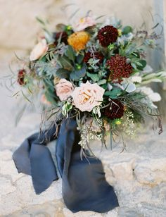 Charcoal gray ribbon, blush colored roses, accents of burgundy and deep red and a pop of marigold. These bohemian luxe flowers are absolutely gorgeous in their rich and yet subdued color palette.