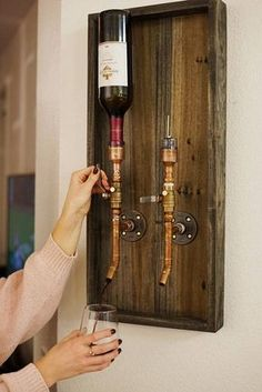Made to order custom liquor dispenser with copper piping. This dispenser can hold two bottles, but we make them to hold one and three bottles as well. These are perfect for pouring a nice glass of whiskey or wine. It fits most 1L and 750ML bottles with a standard 1 opening. It is