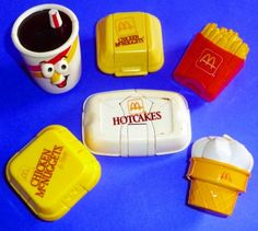 Old-school Happy Meal toys - McDonald's version of transformers. The hot cakes one turned into a pterodactyl! (dude, I have some of these!)