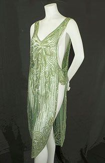 Beaded green flapper overdress, c.1925.  This tabard-style overdress adapts to a variety of figures. The recognizable antique quality of the beading and the enchanting green hue will show that the wearer belongs to the aristocracy of style. Z