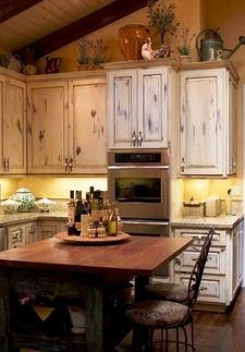 a rustic distressed wood kitchen - decorating a tuscany style kitchen inspiration