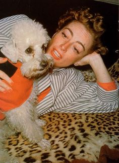 Joan Crawford and her white poodle