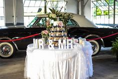 Classic Packards add a touch of vintage elegance to events at the Packard Proving Grounds and make for a lovely back drop for a dessert table too!  #PackardProvingGrounds #GarageWeddings #PackardEvents