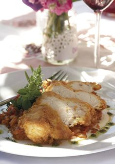Chicken breast in a Parmesan crust on tomato risotto