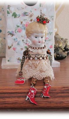 Corky Charlotte Doll by Melanie`s Artful Interludes: She is blonde & one of a kind. Her main body is made with a Champagne cork while her arms are made with glass beads & charms that are movable so she can kick up her little red boots! On top of her head she wears a crown with a little bird perched on top.