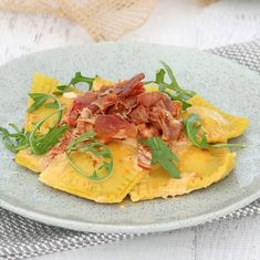 This Homemade Roasted Pumpkin Ravioli with Creamy Sun-Dried Tomato Sauce & Crispy Prosciutto is the perfect family dinner! Make your own pasta dough from scratch or use store-bought fresh pasta sheets. It's so delicious! Umm how