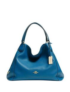 Like this style? Shop Coach and more at Avenue K, where fashion crosses borders.