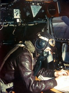 """In the nose of an 8th AF Boeing B-17 """"Flyiner Fortress"""" the navigator charts the course to a German Industrial target."""