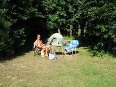 Relaxing outside our tent at Creuse Nature in France.