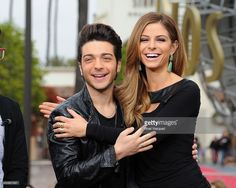 <a gi-track='captionPersonalityLinkClicked' href=/galleries/search?phrase=Gianluca+Ginoble&family=editorial&specificpeople=5945022 ng-click='$event.stopPropagation()'>Gianluca Ginoble</a> of Il Volo and <a gi-track='captionPersonalityLinkClicked' href=/galleries/search?phrase=Maria+Menounos&family=editorial&specificpeople=203337 ng-click='$event.stopPropagation()'>Maria Menounos</a> visit 'Extra' at Universal Studios Hollywood on November 20, 2013 in Los Angeles, California.