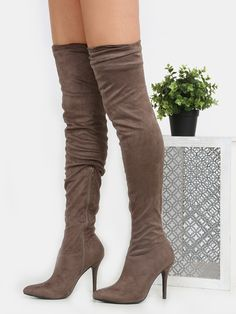 Amp up your style game with the Slouchy Stiletto Thigh High Boots! Features a…