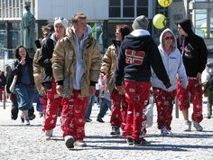 Russ students in Norway.  The HS graduation tradition in which you wear these overall-type pants for a MONTH without washing them, act crazy, and drink a lot.  I saw a line of them crawling on their hands and knees through town and everyone acted like it was totally normal.