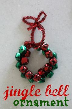 Use small jingle bells and a pipe cleaner to make this festive and simple jingle bell wreath ornament!