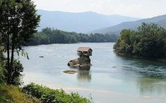 tiny rock homes | Tiny Building On Rock in Middle of Serbian River