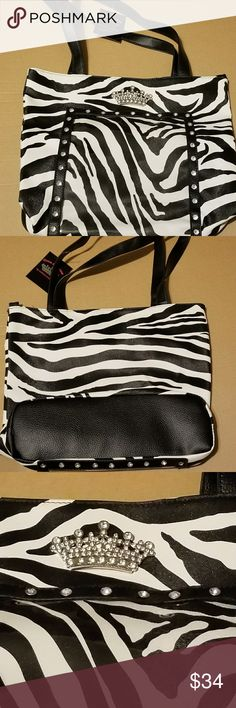 Pageant or dance mom photo zebra bag NWT zebra animal print bag.  Great size for holding a good amount of supplies.  Front of purse has a clear place to hold a photo.  14x14.5x4. Measurement is approximate. 11 inch strap. Queens Collection Bags