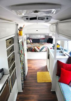 Inside a renovated Airstream trailer- Check the handles on the wood drawers…: