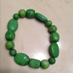 Beautiful green stone stretchy bracelet Pairs well with other bracelets! I wore it with a white strappy white watch in the Summer and it really popped! Multiply color bracelet is just an example, not for sale, unless u know someone named Leah! Jewelry Bracelets