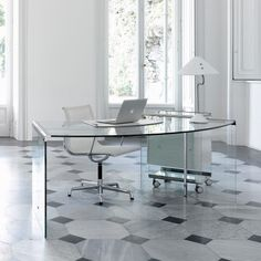 Glass desk.. for office use, home use, or gaming. Just looks cool!