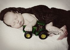 newborn and tractor (but a red one of course!)