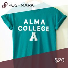 Alma Michigan College Teal Cotton T-Shirt Ter Cute, bright teal cotton Alma College T-shirt. Short sleeves, white solid letters. Liberal Arts College from my very own hometown. Represent! :)  Fit for an xs/sm  Fast shipping! Tops Tees - Short Sleeve