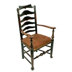 Georgian Elm Macclesfield Arm Chair   A large early 19th century Georgian elm rush seated arm chair.  The chair has a yoke shaped top rail to the ladder back and shaped arms worn with age that are supported at the front by turned columns that run down into legs with pad feet.  The front legs are joined with a turned stretcher and pairs of stretchers join the other legs.  The seat has a replaced rushing with a loose contemporary pad seat, is comfortable to sit in and is in good order.  The… Outdoor Chairs, Outdoor Decor, Antique Chairs, Dining Room Furniture, Columns, Georgian, Ladder, 19th Century, Accent Chairs