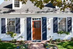 Navy blue shutters with anchor cutouts: http://www.completely-coastal.com/2016/07/small-nautical-theme-cottage-nantucket-style.html