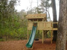 tree fort - but with a tube slide.