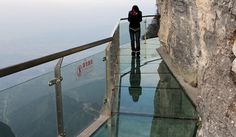 There are loads of glass skywalks around the world that aim to challenge scaredy cats to make the terrifying trek across without tossing their cookies. The Zangjiajie National Forest's amazing 60-meter long bridge encircles the face of the Tianmen Mountain with a 3ft-wide, 2.5 inch thick glass walkway so scary most people make the lap plastered to the cliffside. And when you see the 4,000-foot plunge to the forest below, who can blame them. Skywalk-Tianmen-Mountain-China-4-1