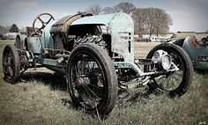 1920's speedster with wire wheels and chain drive.There does not seem to be a radiator in the front but a cooling device of some sort on the rear of the hood at the top of the cowl.