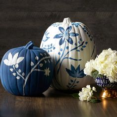 This blue and white pattern comes from an interpretation of traditional Chinese and other East Asian patterns found in decorative arts. Just paint a real or faux pumpkin blue or white, then add floral details. Faux Pumpkins, White Pumpkins, Painted Pumpkins, Traditional Decorative Art, Traditional Chinese, Pumpkin Display, Fall Arrangements, Pumpkin Decorating, Fall Decorating