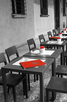 Your Table Is Ready. Photography by Andrea Rea. Black tables are set with red placemats and menus outside a stylish Italian restaurant in old city Bologna. Monochrome with selective color. Original work available as framed print, canvas and more only on Fine Art America and Pixels.com. https://andrea-rea.pixels.com/