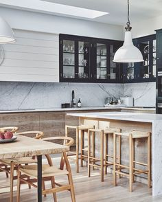 A modern interpretation of cabinetry styling and aesthetic. A harmony of materials, from the cool soft touch of the honed Carrara marble… Kitchen Island Table, New Kitchen Cabinets, Kitchen Layout, Kitchen Reno, Best Kitchen Designs, Modern Kitchen Design, Interior Design Kitchen, Kitchen Contemporary, Farmhouse Kitchen Decor