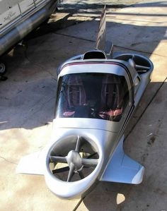 """Flying Car - It's called """"The Highway in the Sky,"""" and here's how it works: Every time you're stuck in traffic, you can flip a switch and swoop into the sky (via CBS News)"""