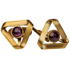 Antique Russian Garnet Gold Cufflinks. made in Moscow between 1908 and 1917  These unusual cufflinks are designed as twisted gold ribbons forming eternity triangles with bezel-set cabochon-cut rhodolite garnets in their centers.