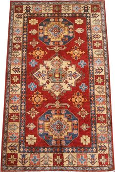 Today's Kazak is a modern shape of old Caucasian rugs which strictly adheres to traditional design elements of the Caucasus. It has elements such as the stepped hooked polygons, geometrical medallions and rosettes, presented in more stylized manner and with a new dimension.  http://www.alrug.com/4612
