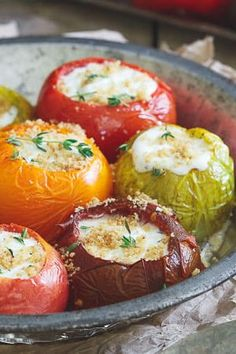 These roasted stuffed heirloom tomatoes are filled with a goat cheese, creme fraiche, thyme mixture and topped with garlic butter breadcrumbs for a wonderful late summer side dish.