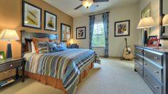 A teenage boy's bedroom retreat by Darling Homes at Woodforest. #boysbedroom #teenageboybedroom #masculinebedroom