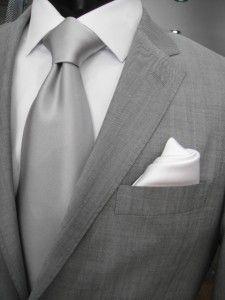 Grey suit & silver tie.