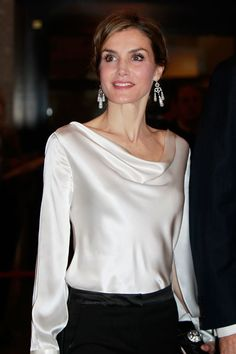 "King Felipe and Queen Letizia attend the opera ""The Public"" at the Royal Theater in Madrid. Princess Letizia, Queen Letizia, Mode Outfits, Fashion Outfits, Satin Bluse, White Shirts, Royal Fashion, Blouse Styles, Classy Outfits"