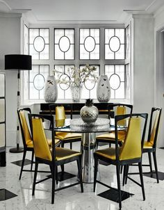 Dining room with gleaming silver & gold vinyl covered Italian chairs