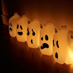 Re-purpose empty milk jugs with this easy Halloween do-it-yourself idea. Just use black tape to make faces and add tea lights. Brought to you by TwistOP.com