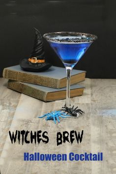 Witches brew Halloween cocktail and witch hat on books with spiders Spooky Halloween Decorations, Halloween Party Favors, Halloween Cocktails, Holiday Drinks, Craft Cocktails, Cocktail Drinks, Halloween Treats, Fun Drinks, Halloween Fun