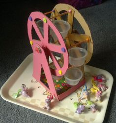 Thanks to inspiration found on Pinterest, I've made this ferris wheel for my daughter this week. Out of cardboard, fruit containers, bamboo sticks, straws, paperclips and some beads. Am pretty chuffed with myself. ;-)