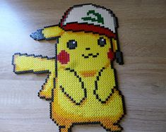 Perler beads - Pikachu sprite from Pokemon Sun and Moon Pokemon Perler Beads, Pokemon Moon And Sun, Pokemon Sun, Fuse Beads, Pearler Beads, Pixel Beads, Pikachu, Pixel Art, Melting Beads