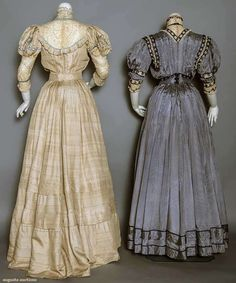 "TWO SILK AFTERNOON DRESSES, c. 1908 Both 2-piece: 1 navy & white pin stripe, bodice w/ puffed short sleeves, lace & navy silk soutache trims, matching belt, B 32"", W 33"", Skirt L 40""; 1 beige raw silk, Cluny bobbin lace & baby blue linen & embroidered bodice trims, puffed 3/4 length sleeves, hem tucks on skirt, B 34"", W 23"", Skirt L 41""-46"""