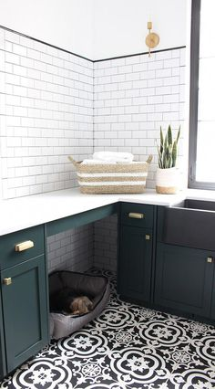 The Laundry/Dog Room: Dark Green Cabinets Layered On Classic Black + White Design - The House of Silver Lining - - A modern classic black and white laundry room layered with gorgeous dark green cabinets and natural white oak wood accents. Black And White Tiles, Black White, Black And White Design, Dark Green Bathrooms, White Bathrooms, Laundry Room Cabinets, Bathroom Laundry, Downstairs Bathroom, Bathroom Cabinets