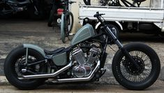 Honda Shadow VT600 custom with black rims and gray paint job